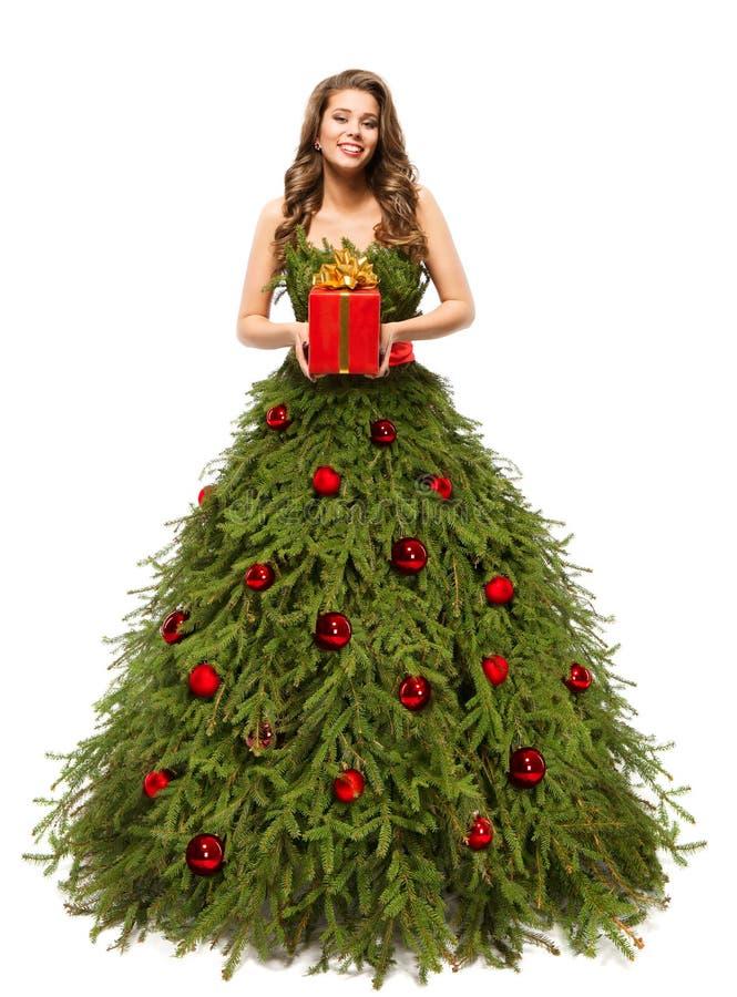 Julgranklänning, modekvinna med den närvarande gåvan, vit royaltyfria bilder
