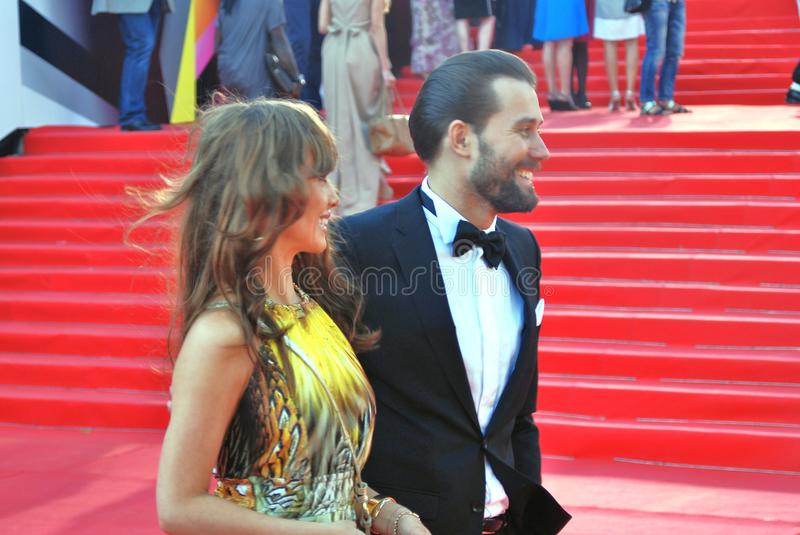 Julia Beretta and Daniil Fedorov at Moscow Film Festival. Actress and singer Julia Beretta and actor Daniil Fedorov smile and pose for photos at XXXV Moscow royalty free stock photography