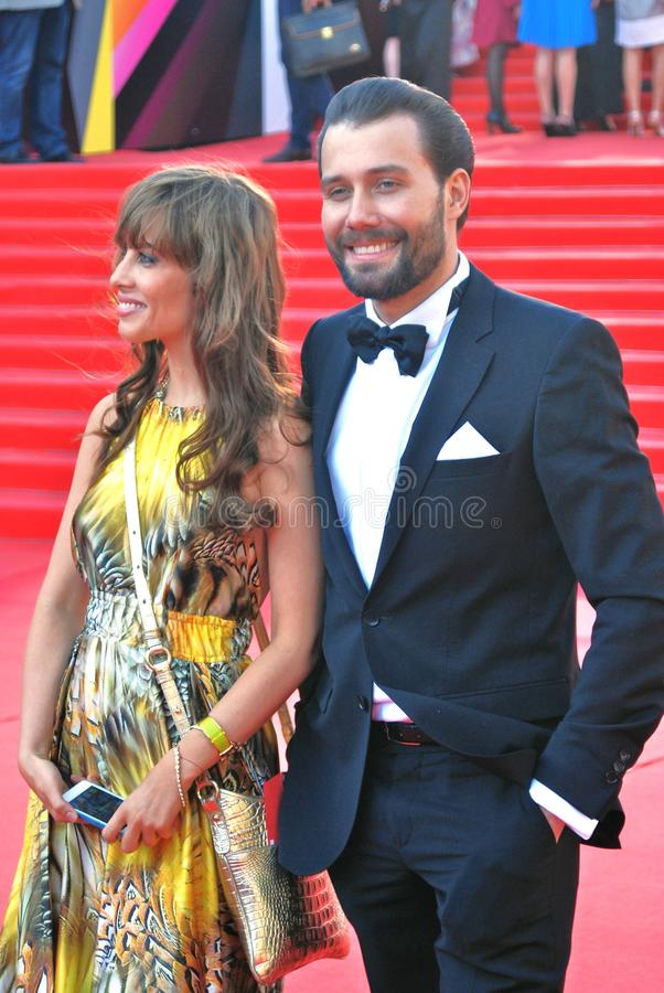 Julia Beretta and Daniil Fedorov at Moscow Film Festival. Actress and singer Julia Beretta and actor Daniil Fedorov smile and pose for photos at XXXV Moscow stock photo