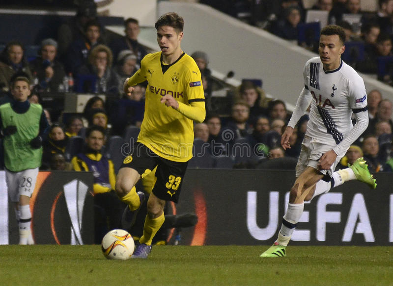 Julian Weigl and Dele Alli. Football players pictured during UEFA Europa League round of 16 game between Tottenham Hotspur and Borussia Dortmund on March 17 stock photos