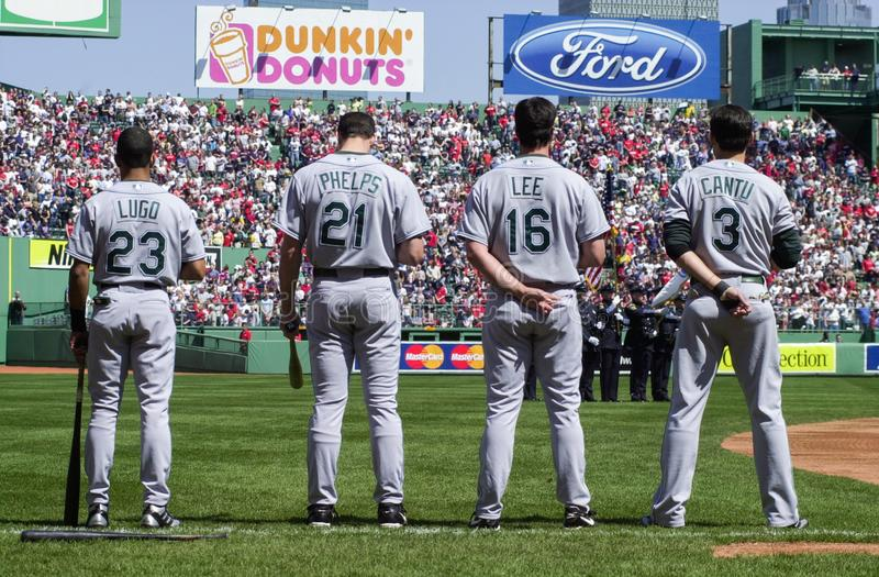 Tampa Bay Rays observe National Anthem. Julio Lugo, Josh Phelps, Travis Lee and Jorge Cantu stand for the National Anthem. Image taken from color slide stock photo