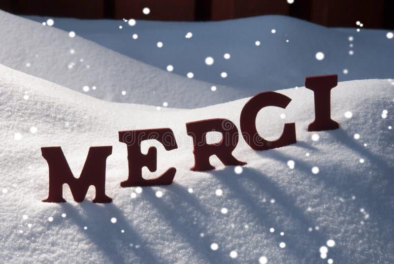 Julkortet med snö, det Merci medlet tackar dig, snöflingor arkivbild