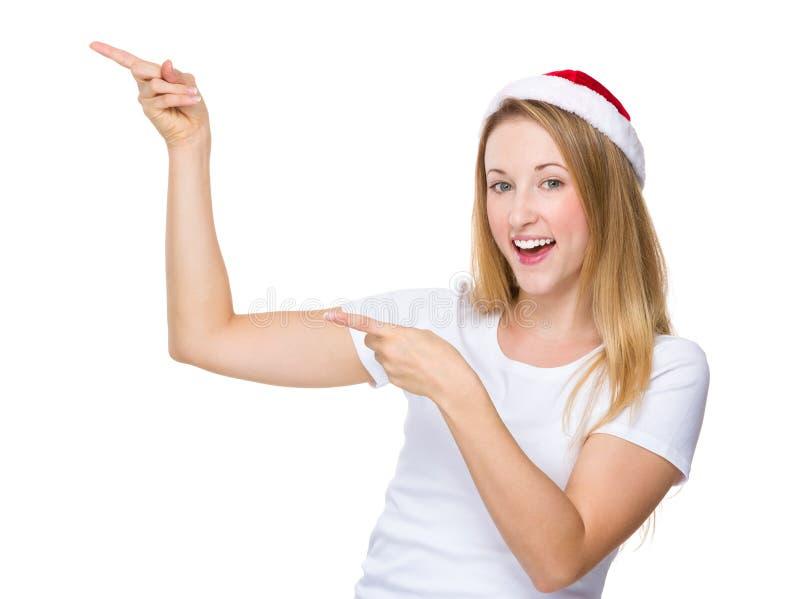 Julkvinna med punkt för två finger upp arkivfoton
