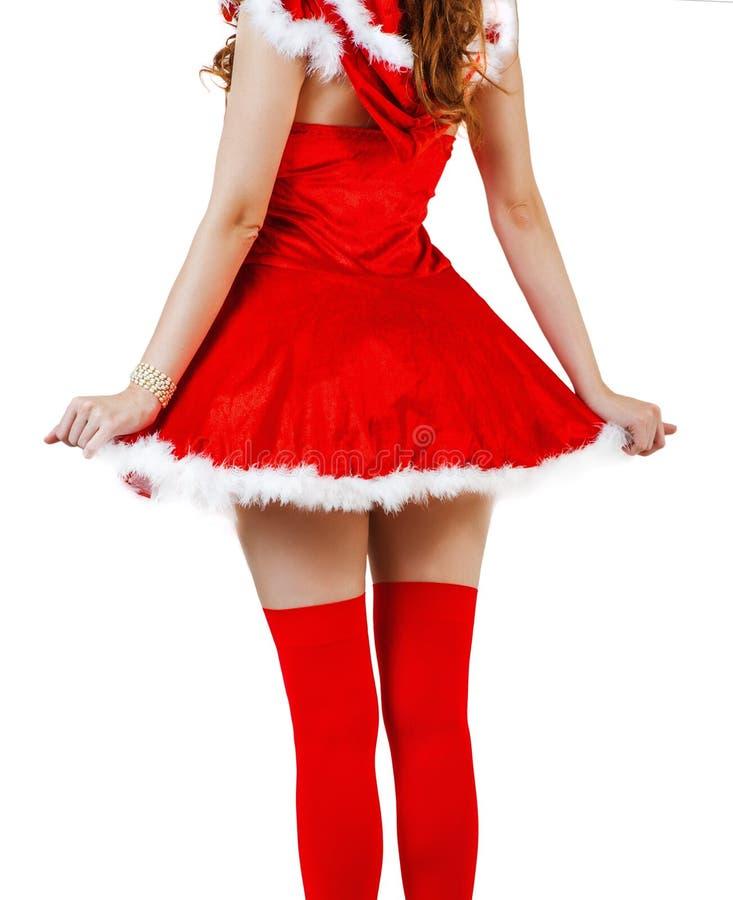 Julkvinna som bär den röda Santa Claus klänningen arkivfoto
