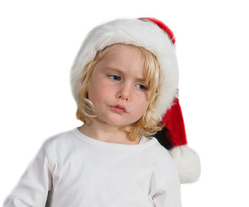 Julliten flicka med jultomtenhatten royaltyfri bild