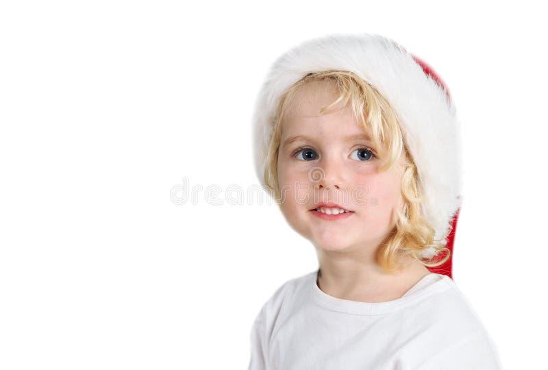 Julliten flicka med jultomtenhatten royaltyfria bilder