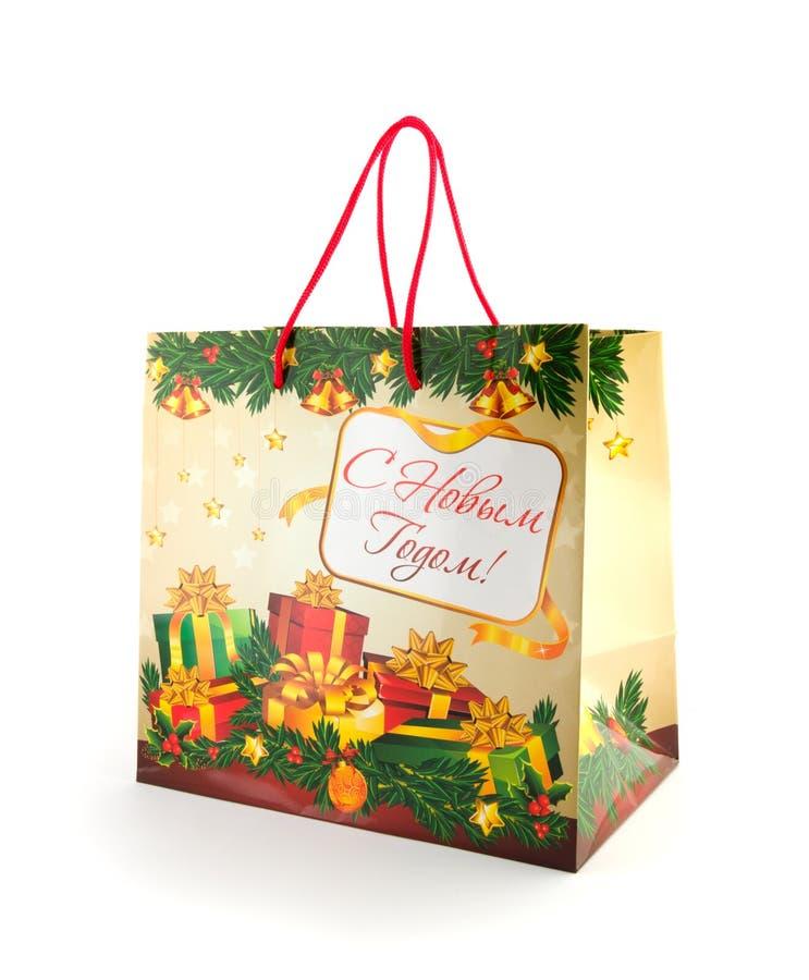 Julpaket med hälsning som isoleras på vit royaltyfria foton