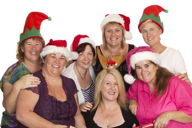 Julpartiet poserar för en grupp av kvinnor arkivbild