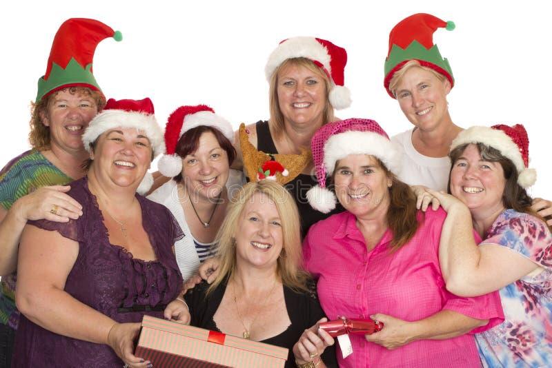 Julpartiet poserar för en grupp av kvinnor fotografering för bildbyråer