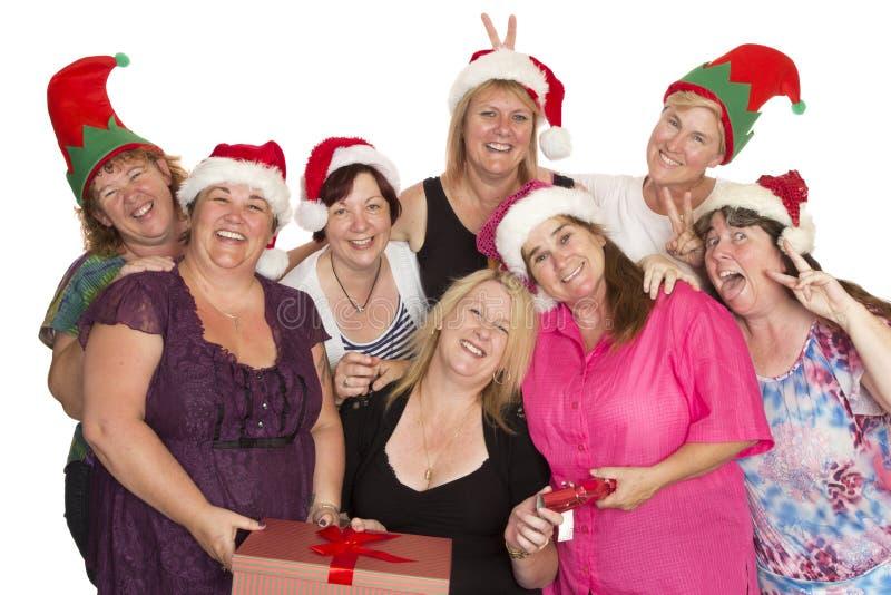 Julpartiet poserar för en grupp av kvinnor arkivbilder