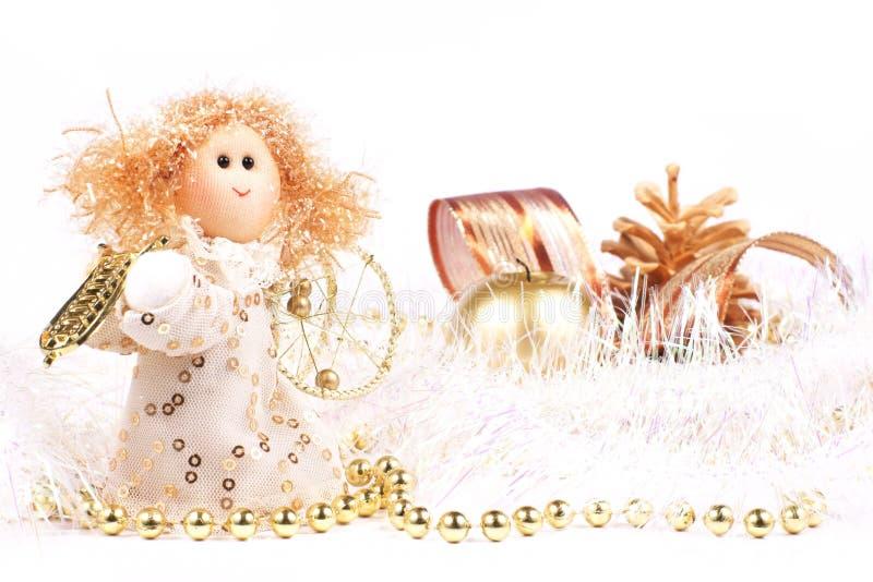 Julpynt, ängel och stearinljus royaltyfria foton