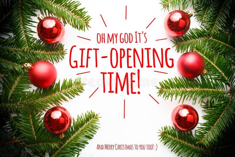 Julpynt med meddelande`en oj min gud det gåva-öppning för ` s tid! `, arkivbild