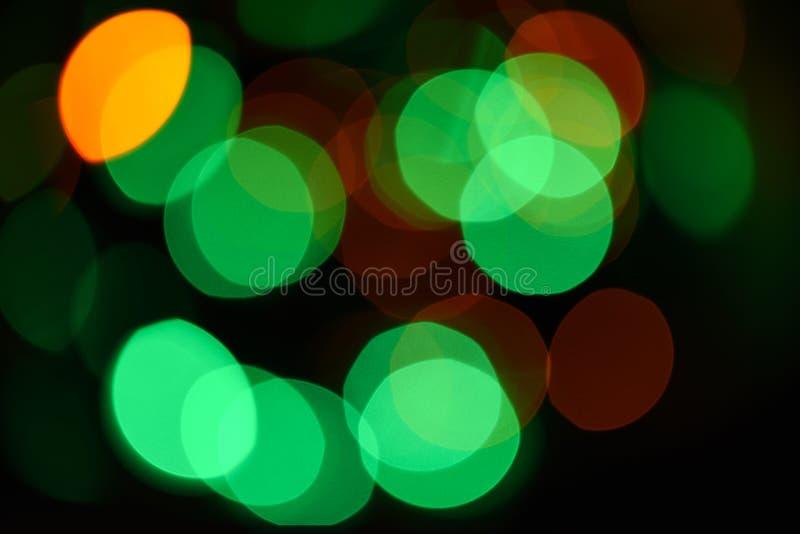 Julpyntbegrepp Defocused ljus av den färgrika girlanden abstrakt färgrik bakgrundsbokeh festlig bakgrund arkivbild