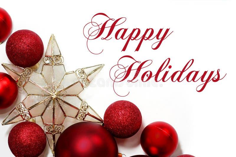 Julpyntgräns med lyckliga ferier för text arkivbilder
