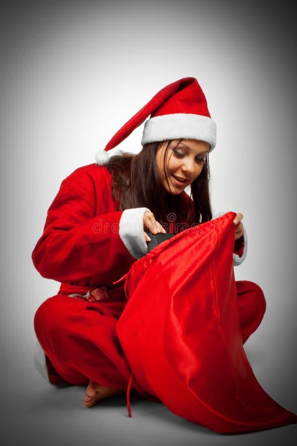 julsäck santa royaltyfria bilder