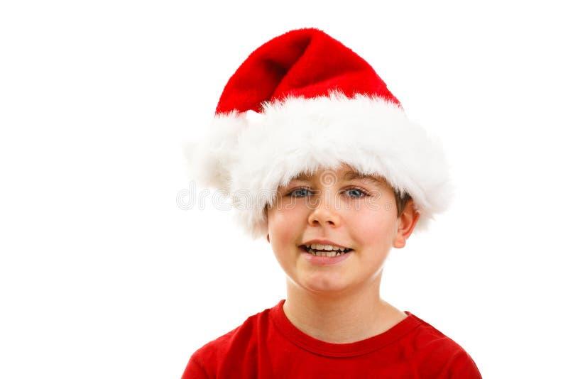 Jultid - pojke med Santa Claus Hat royaltyfri fotografi
