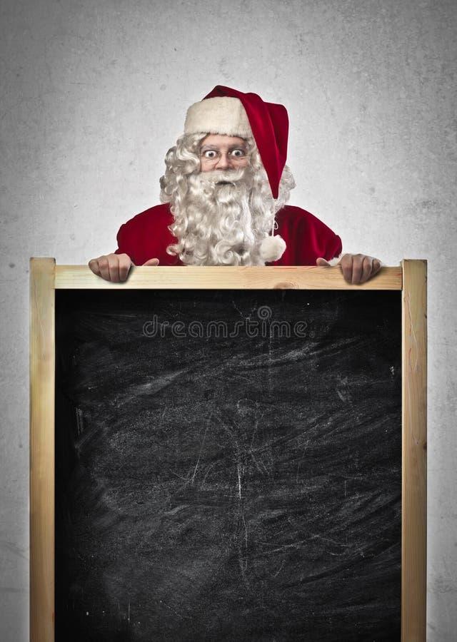 Jultomte Blackboard royaltyfri fotografi