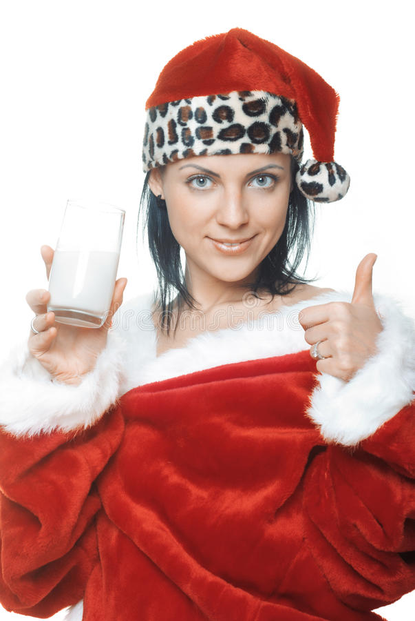 Jultomten med mjölkar arkivfoton