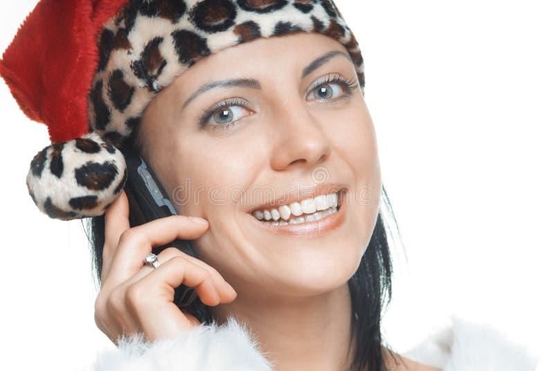 Jultomten med mobiltelefonen arkivfoto