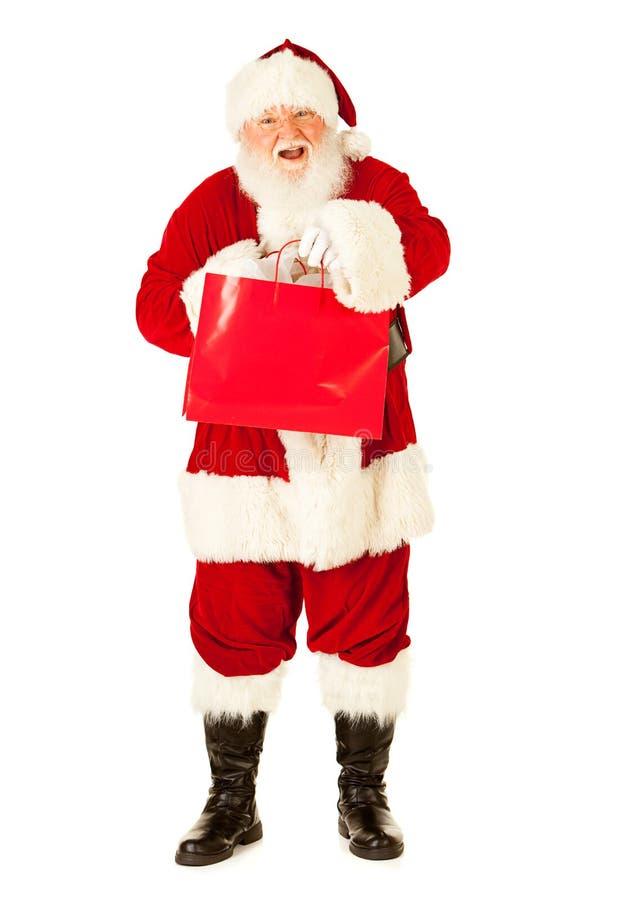 Jultomten: Santa Excited To Do Christmas shopping royaltyfri foto