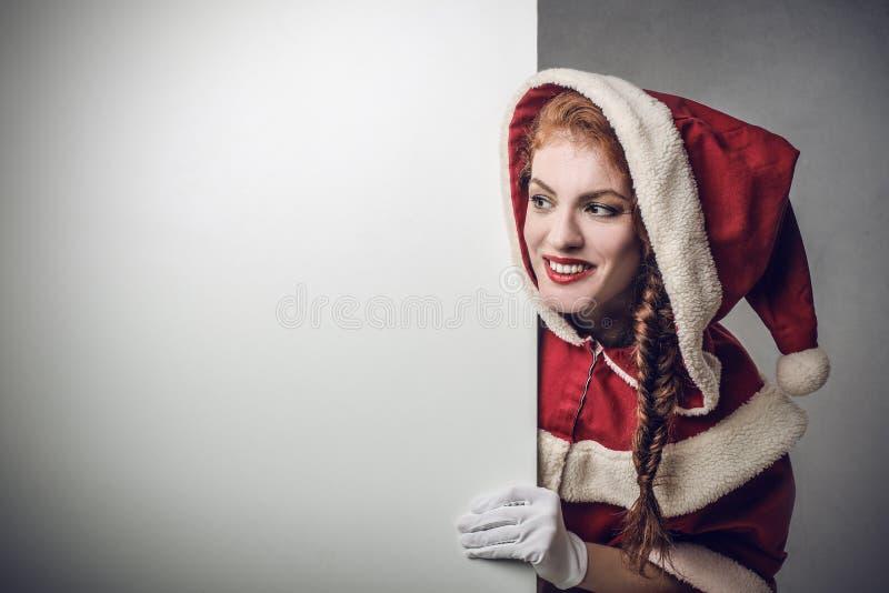 Jultomten som bort ser royaltyfri bild