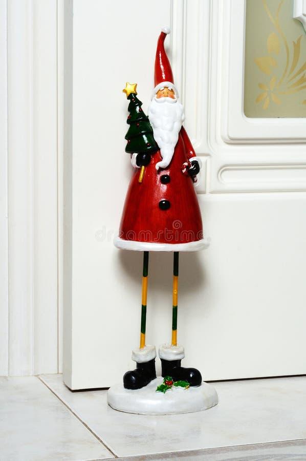 Jultomtendörrstopp. royaltyfri fotografi