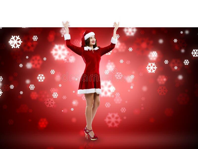 Jultomtenflicka med banret fotografering för bildbyråer