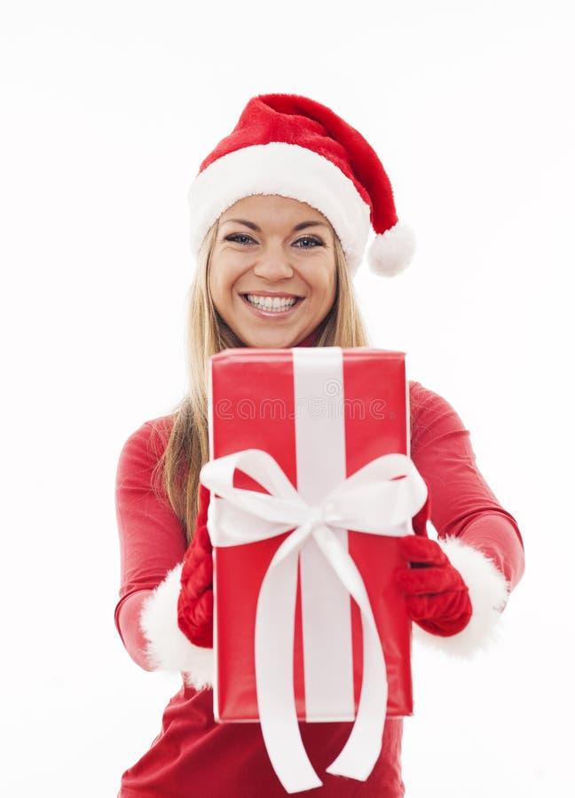Jultomtenflicka med gåvan arkivbild