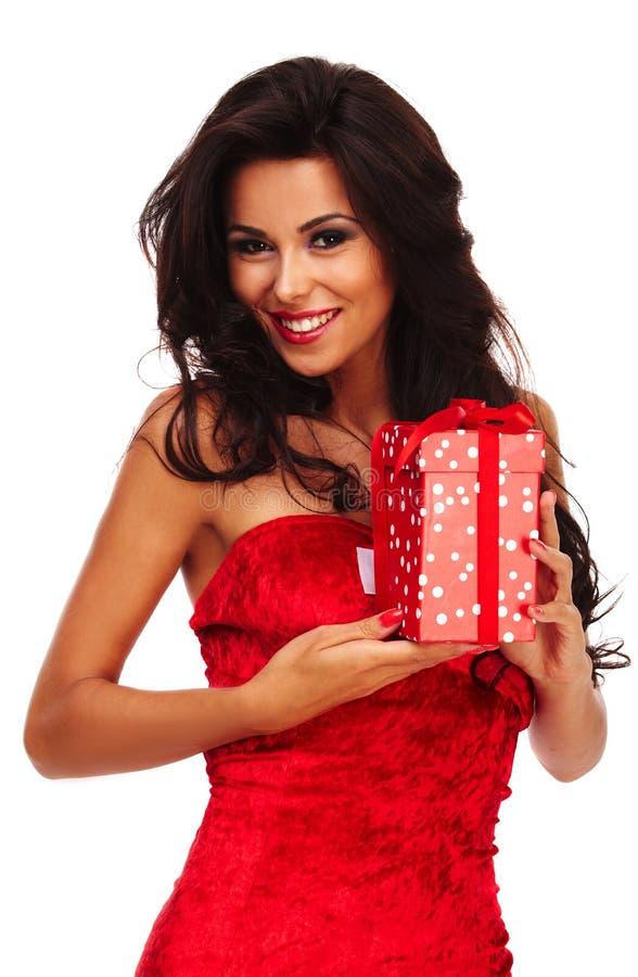 Jultomtenhjälpredaflicka på vit bakgrund med långt hår och röd gif royaltyfri bild