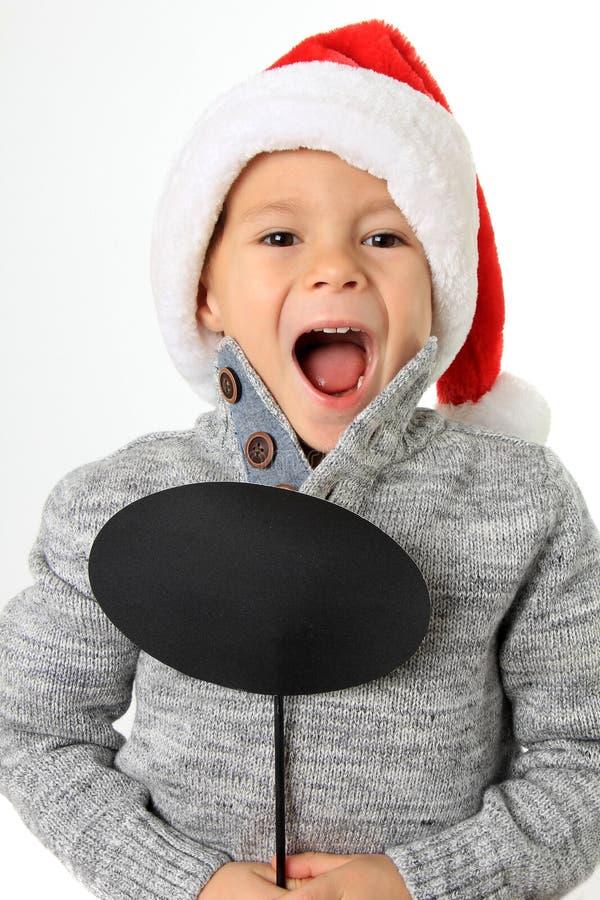 Jultomtenpojke med anförandebubblan arkivfoto
