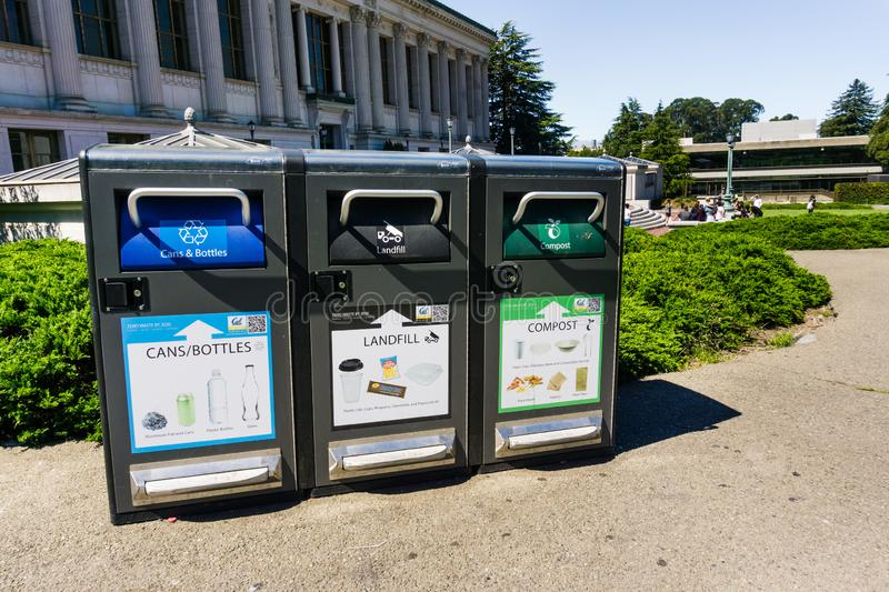 July 13, 2019 Berkeley / CA / USA - Recycling cans and bottles, Landfill garbage and some types of plastics and Compost food stock images