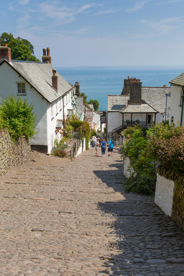 The July heatwave in England saw tourists flocking to Clovelly Devon. CLOVELLY, DEVON, UNITED KINGDOM -JULY 14th 2013: The July heatwave in England saw families royalty free stock photography