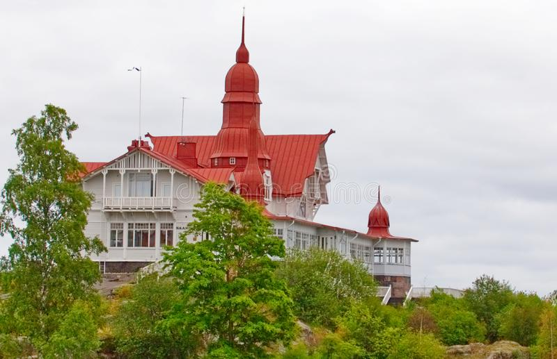 Red mansion on Helsinki hill royalty free stock photography