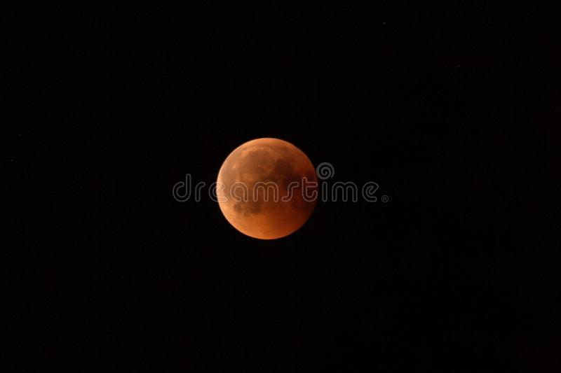 July 27, 2018 is the longest lunar eclipse of the century. The moon is painted red-brown because of the shadow of the royalty free stock photos