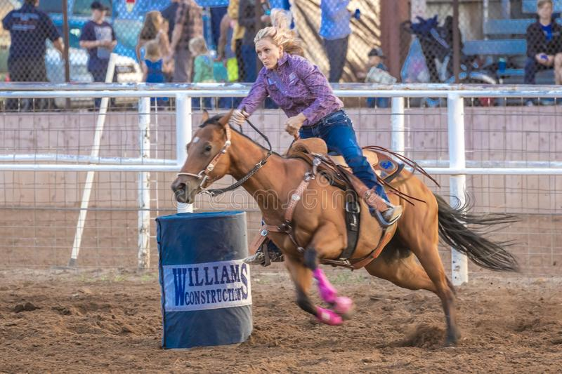 JULY 22, 2017 NORWOOD COLORADO - Cowgirl rides fast for best time during San Miguel Basin Rodeo,. Colorado, western stock photo