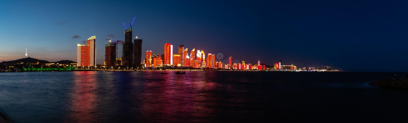 July 2018 - Qingdao, China - The new lightshow of Qingdao skyline created for the SCO summit. Between China and Russia of June 2018 seen from the Bathing Beach royalty free stock image