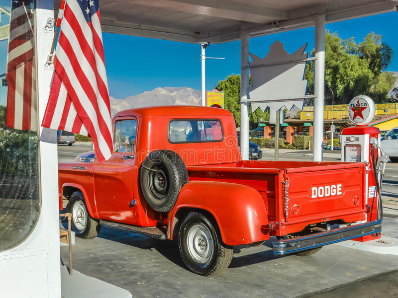 July 22, 2016 - Red Dodge Pickup truck parked in front of vintage gas station in Santa Paula, California stock images