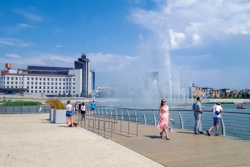 July 2019, Russian Federation, Tatarstan, Kazan.A cascade of fountains on lake Kaban and the adjacent square in front of the Galia stock photography