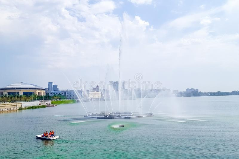 July 2019, Russian Federation, Tatarstan, Kazan. A cascade of fountains on lake Kaban and the adjacent square in front of the Galiaskar Kamal theatre. Sights royalty free stock images