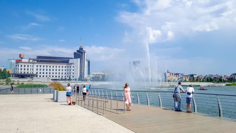 July 2019, Russian Federation, Tatarstan, Kazan. A cascade of fountains on lake Kaban and the adjacent square in front of the Galiaskar Kamal theatre. Sights stock images