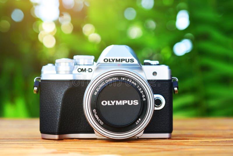 14 July 2019 at Samut Sakhon Thailand people prepare Camera Olympus on wood table vintage before use take photo. Background stock photo