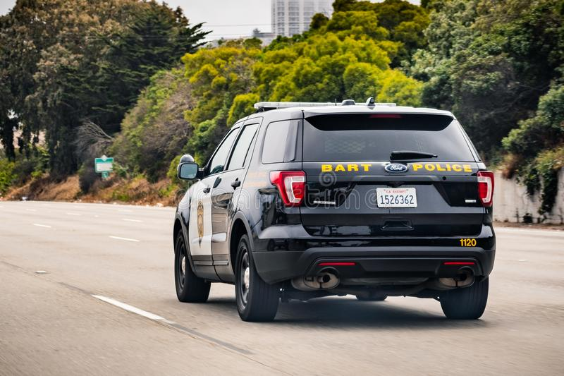 July 4, 2019 San Francisco / CA / USA - BART police vehicle driving on the freeway; BART police is the transit police agency of. The BART rail system stock photography