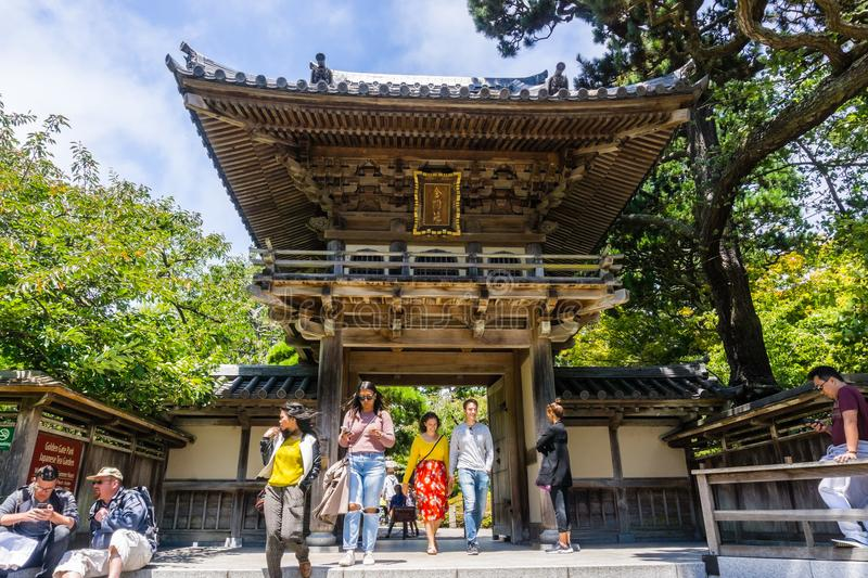 Tourists coming out of the main entrance to The Japanese Tea Garden in Golden Gate Park royalty free stock image