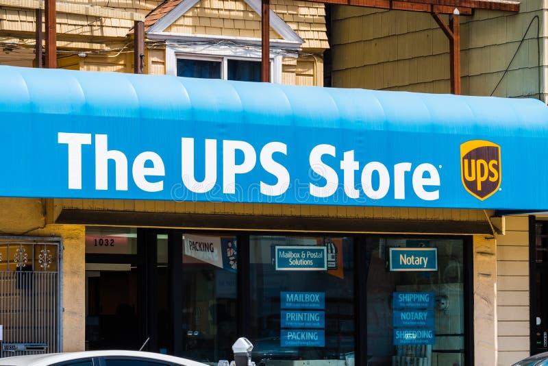 The UPS store logo. July 20, 2018 San Francisco / CA / USA - The UPS store logo placed above the to one of their city locations stock photos