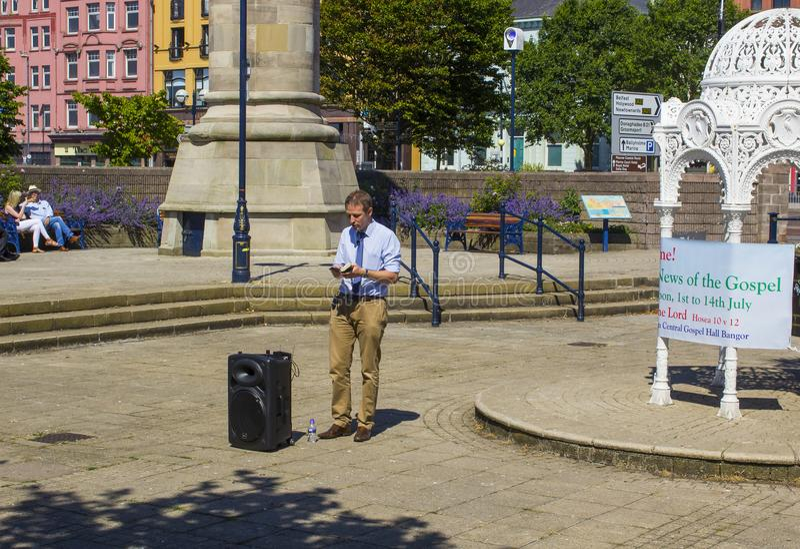 A Street preacher. Preaching the good news of salvation through faith alone in Jesus Christ in the Sunken Gardens Bangor Co Down. 2 July 2018 A Street preacher stock photos