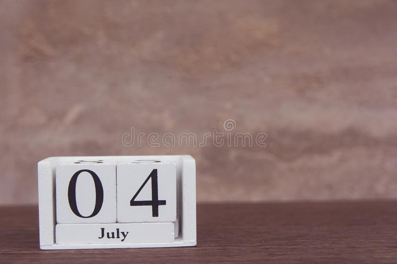July 4 th. of American Independence Day with white block calendar on wooden table. copy space.  royalty free stock image