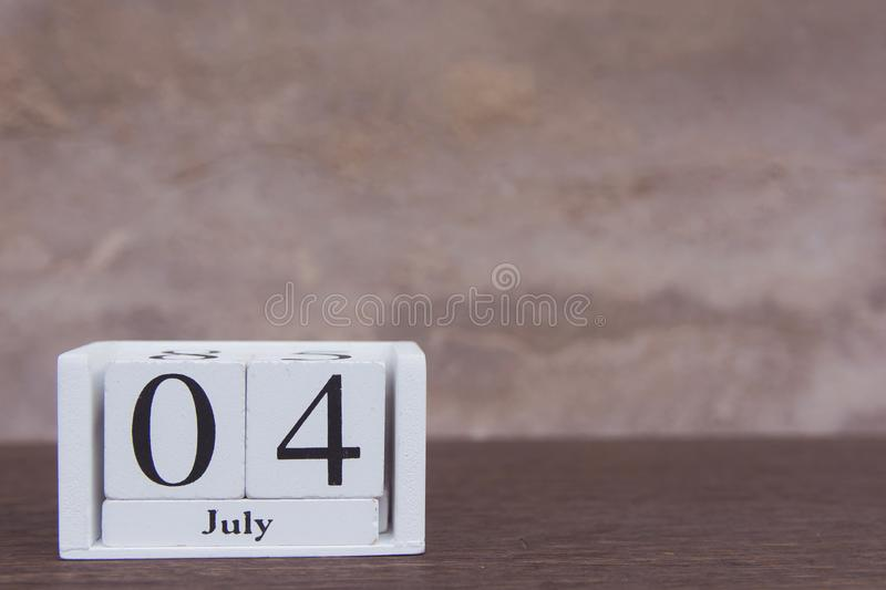 July 4 th. of American Independence Day with white block calendar on wooden table. copy space.  royalty free stock images