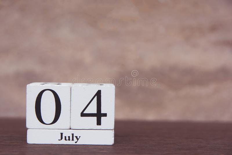 July 4 th. of American Independence Day with white block calendar on wooden table. copy space.  royalty free stock photo