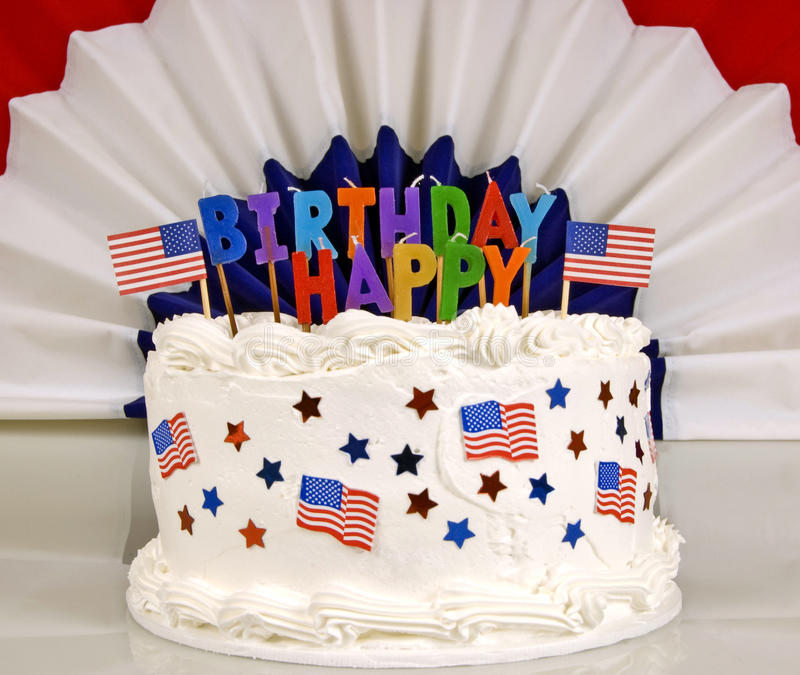 July 4th Patriotic Birthday Cake. Red White And Blue July 4th Birthday Cake with unlit candles and patriotic banner in back stock image