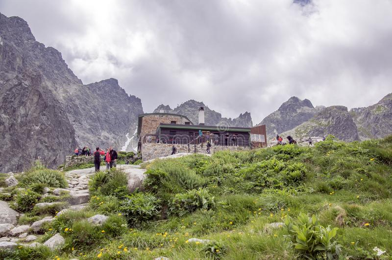 July 6, 2017, tourists in National Nature Reserve Studena dolina in front of Tery cottage, slovakia highest mountains stock image